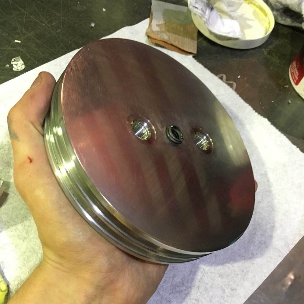 Forward motor bulkhead for Fathom II, in the midst of polishing. There's no shine like Mother's.