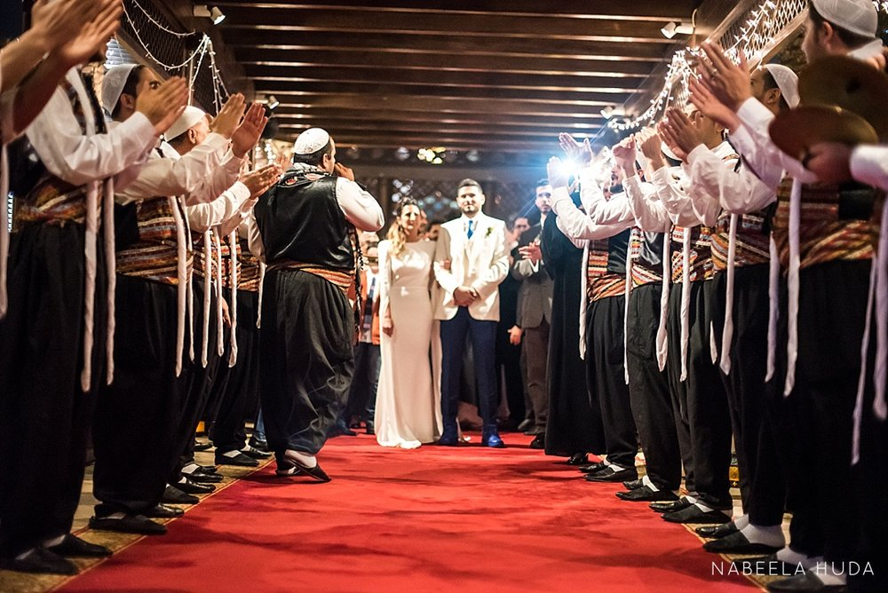 Parents of the groom organize a surprise Zaffa dance for the couple.
