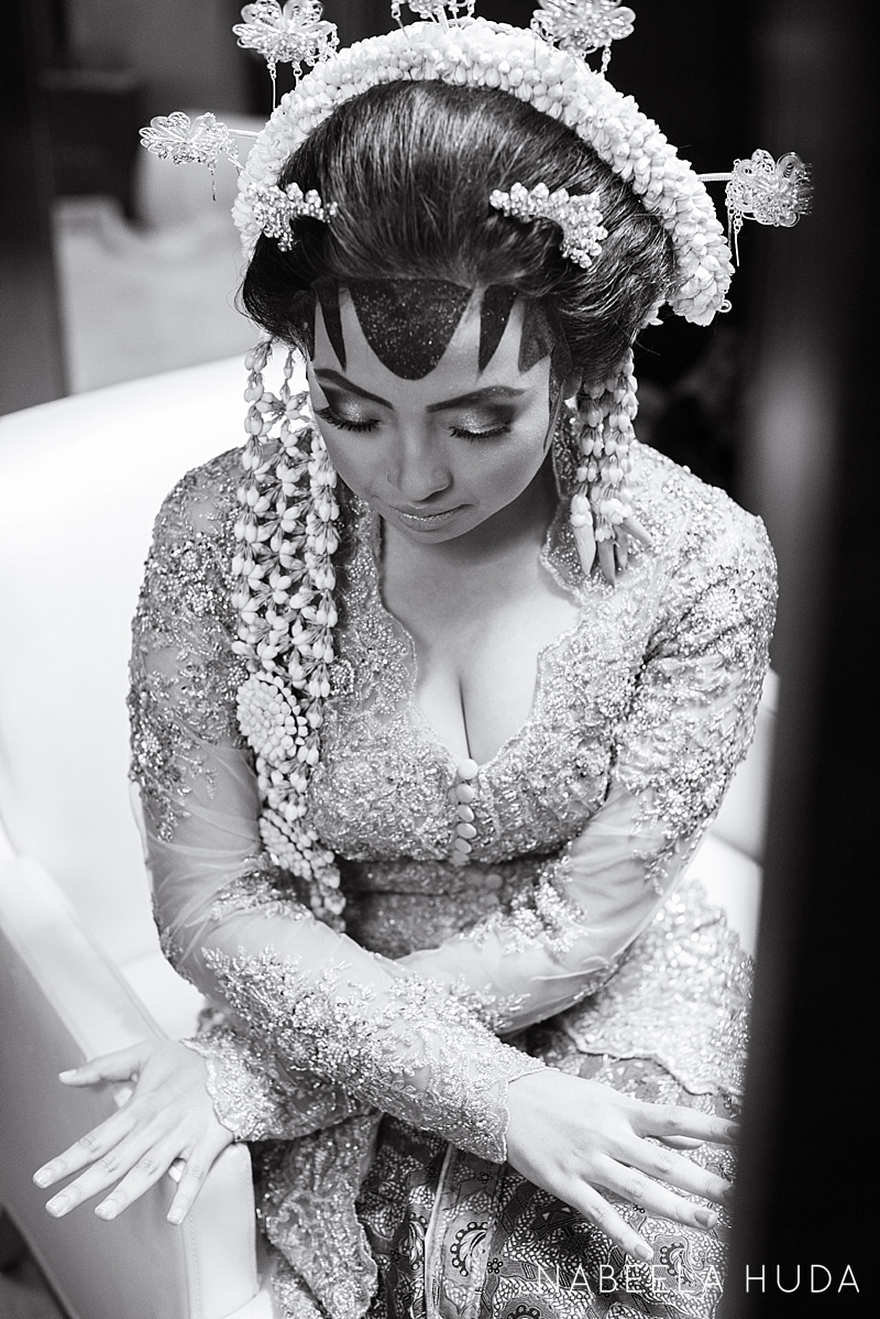 This bride looks stunning as her aunts get her ready for the big day