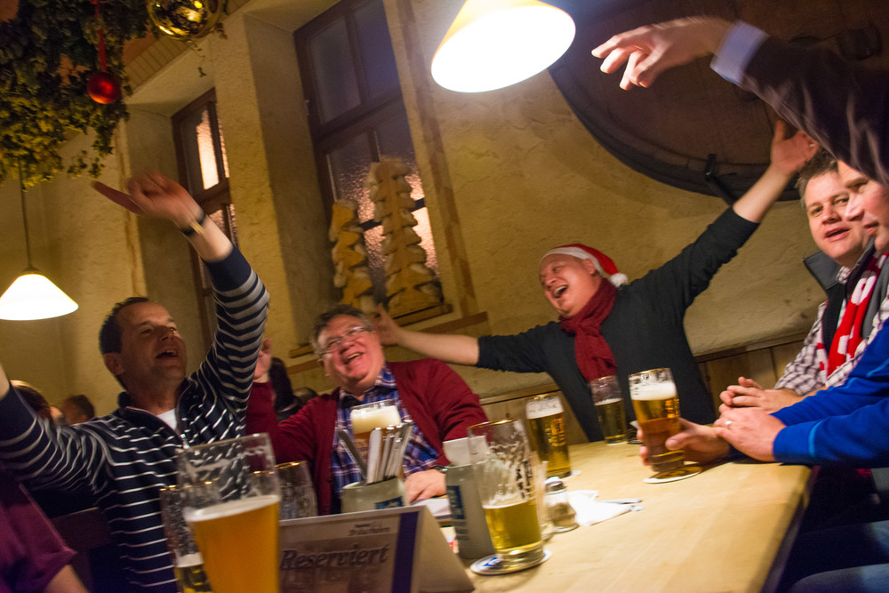 Drinking beers with a rowdy group of Germans in a beer hall in Munich, Germany.