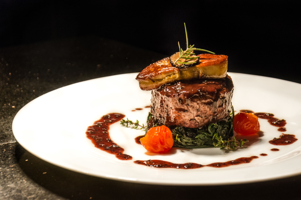 Perfectly prepared steak with foie gras seared on top.