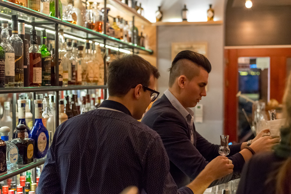 Watching the bartenders carefully pour Hungarian digestifs