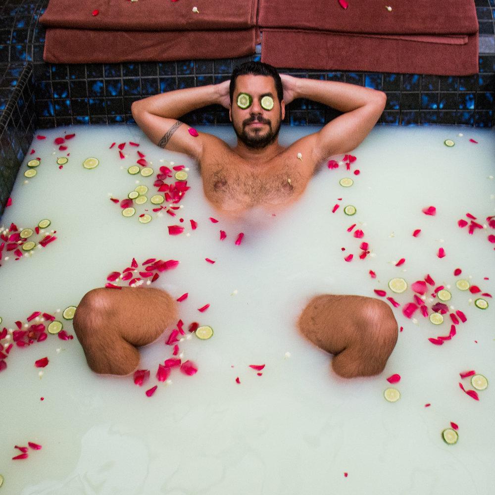 Chris enjoying a milk bath at the Ritz Carlton in Kuala Lumpur, Malaysia