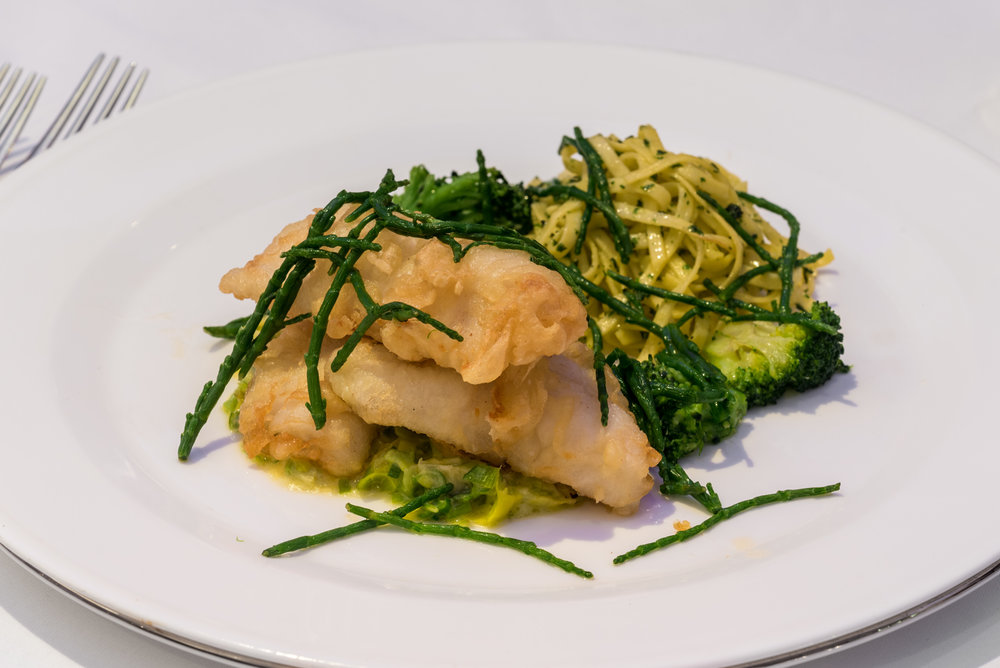 plaice served in tempura batter and accompanied by creamed leeks and fettuccini