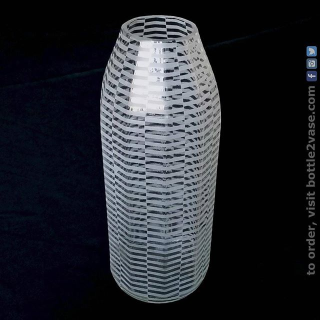 Can you guess how many sides this (upcycled) vase has?  By the time I used up a very unique @fairwaymarket vinegar bottle, I'd already picked out this pattern for it.  The optical illusion lines are actually on the flat parts, which makes it either look like an even more complex shape, or makes it seem to have the same number of edges, only in totally different places. I'm planning to take it to the @jccmanhattan  craft fair tomorrow!  #vinegar #bestfood #fairwaymarket #opticalillusion #homedecor #polygon #unique #bottle #glassart #glass #illusion #urbanglass #jccmanhattan #homegoods