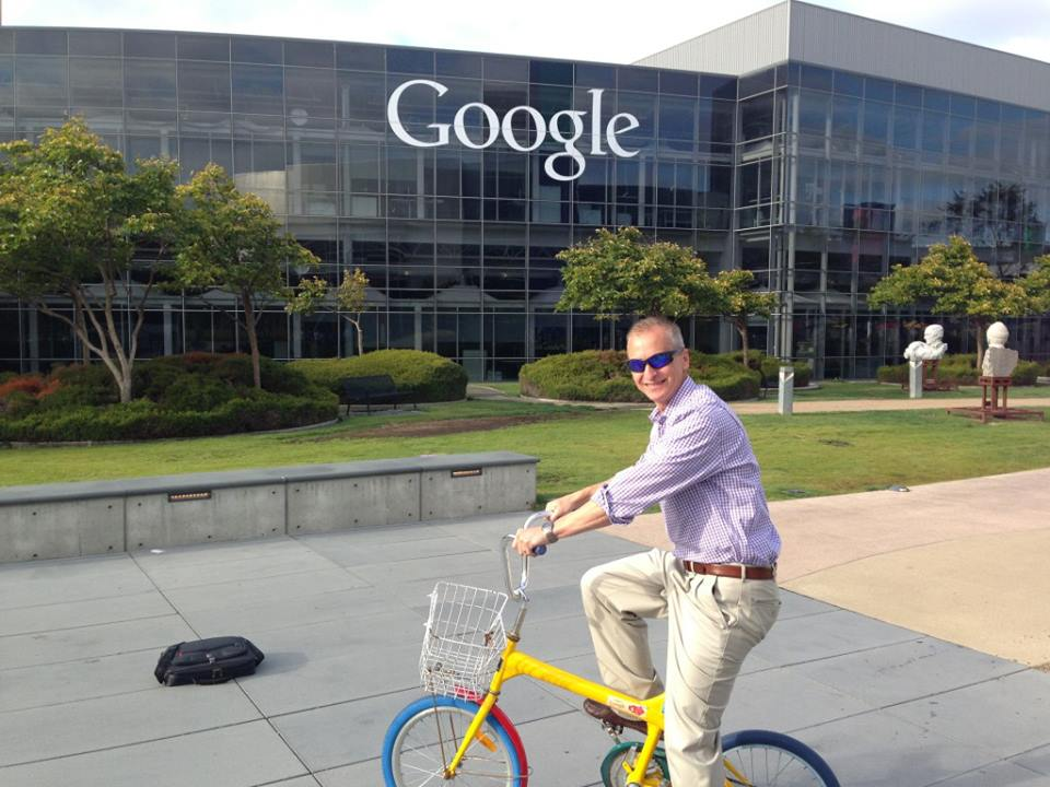 Kevin riding across Google campus