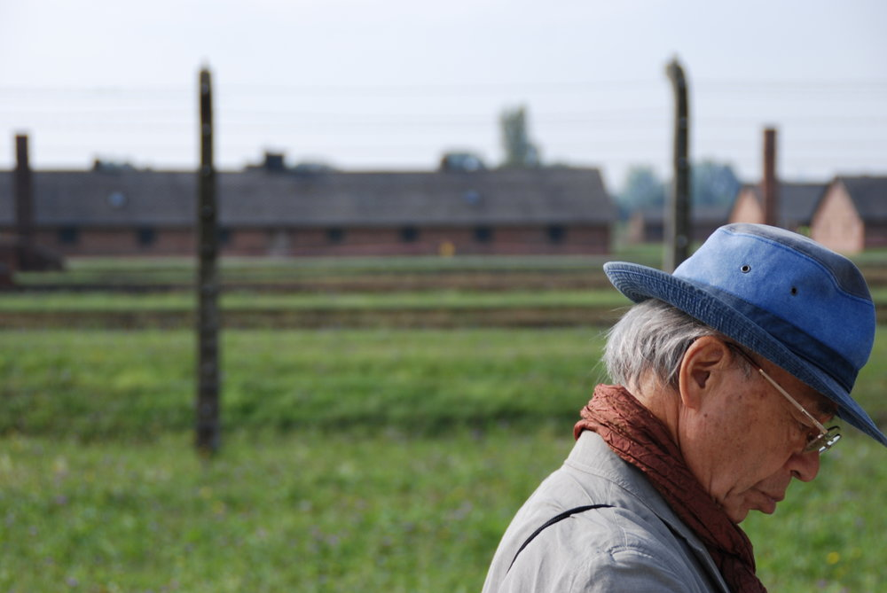 Takeshi Miyata walks through Auschwitz II, also known as Birkenau. He survived the atomic bombing of Nagasaki at the age of 5, and decades later joined Peace Boat to go around the world and share his experience. On this trip him and seven other survivors met a survivor from Auschwitz.