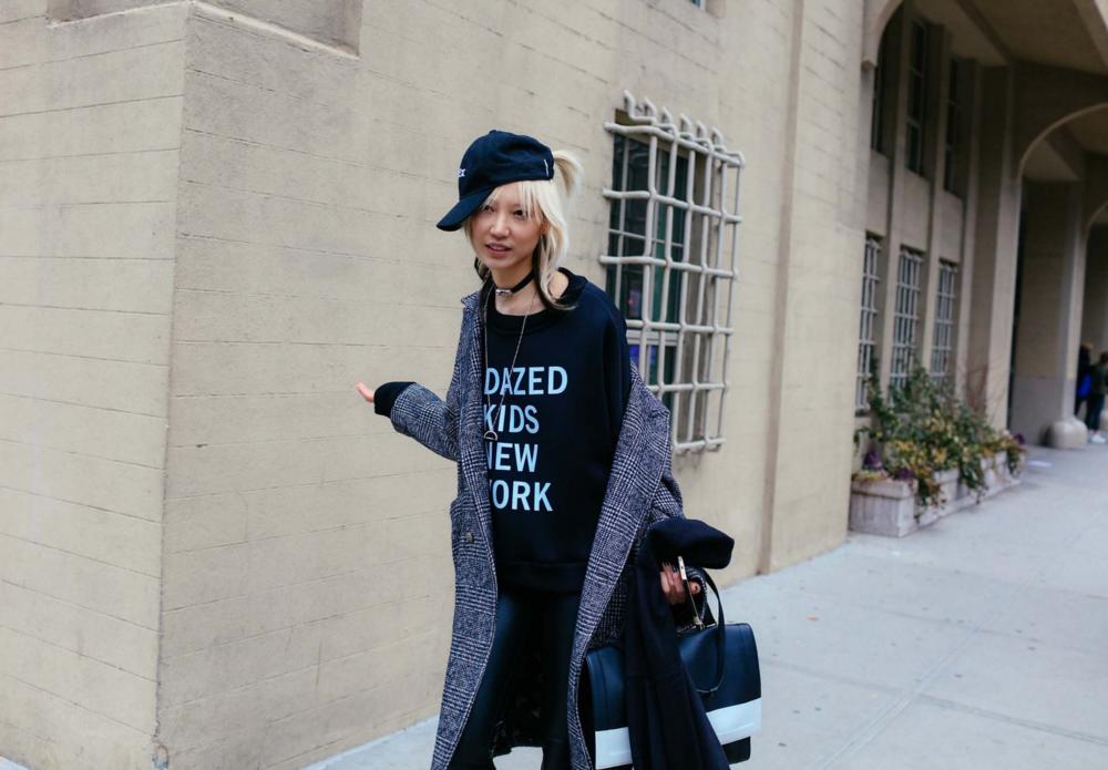 Soo Joo Park in a DKNY sweatshirt