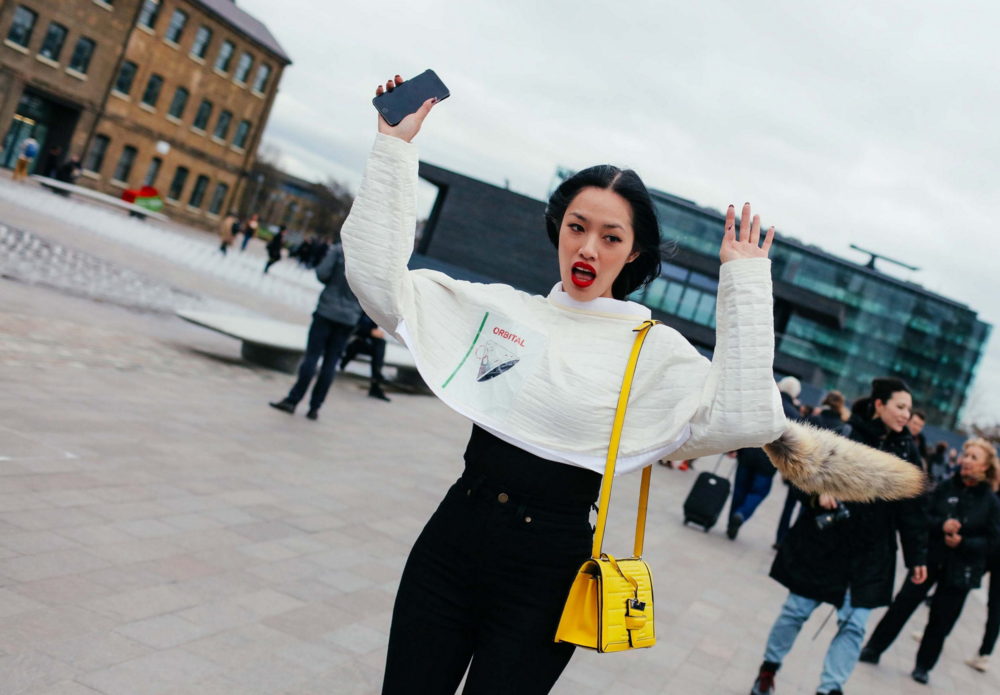 Tiffany Hsu in a J.W. Anderson top with a Loewe bag