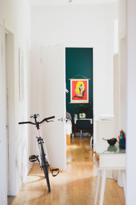 hallway with bike and artwork.jpg