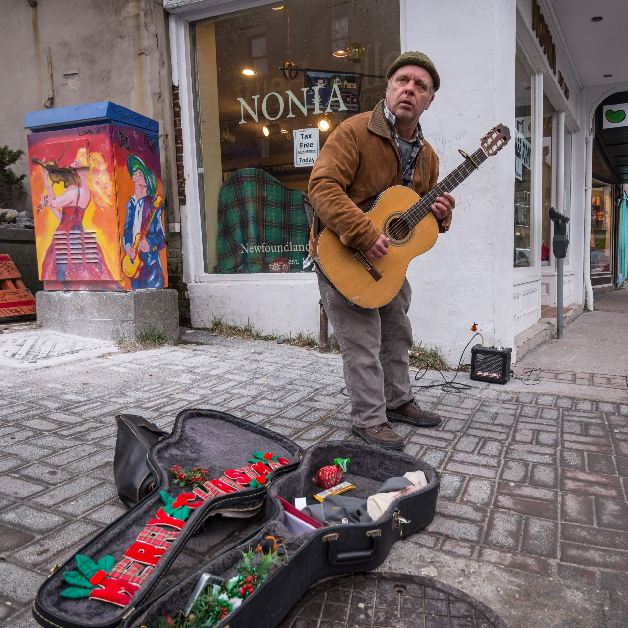 Dec 24 - Stephen Dorian often plays on the corner of Water x George. He had a few tunes going on the eve of the Day of Great Giving.   *DS