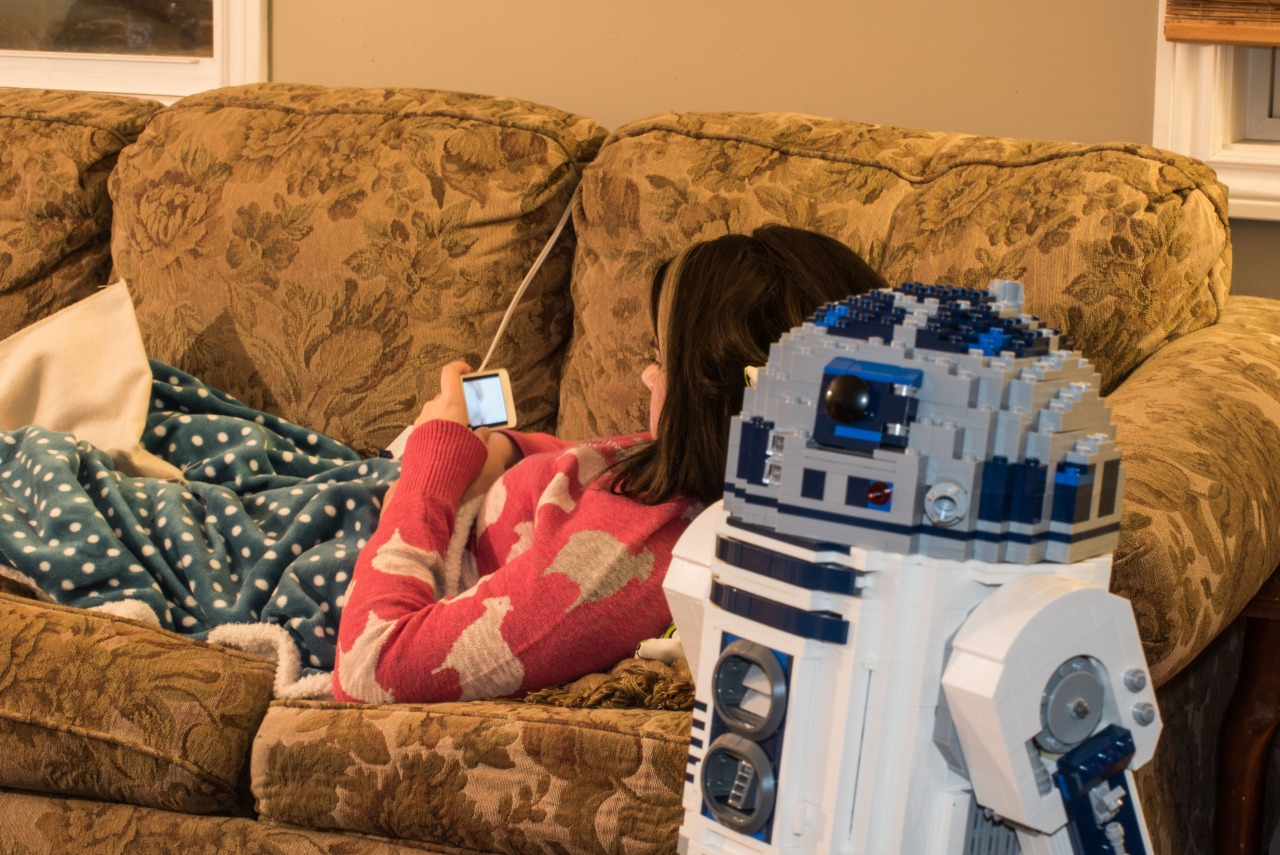 Melissa was chilling out on the couch after our new astromech droid repaired her phone.   *DS
