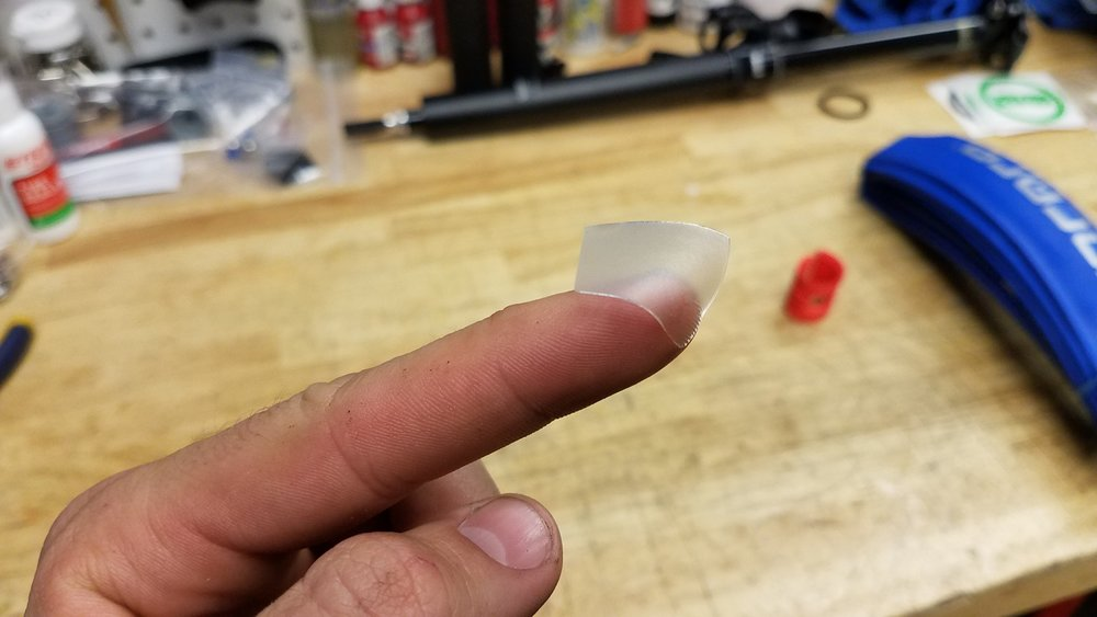 Next, take the transparent sticker and place it over the valve hole. This sticker helps to ensure an optimum valve fit, according to Schwalbe. Our theory is that it improves the seal and prevent air leaks.