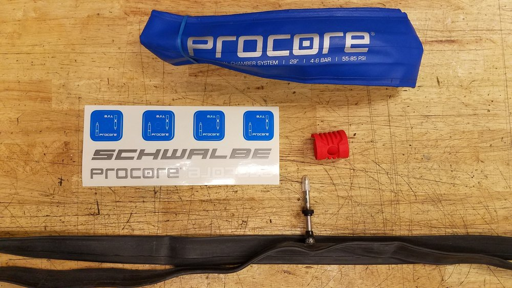 """At its core, this is your core (get it?). Top to bottom, the blue high-pressure inner """"tire"""", the red air guide, and the proprietary inner tube with the dual-chamber valve. Add some sealant, and you're set."""