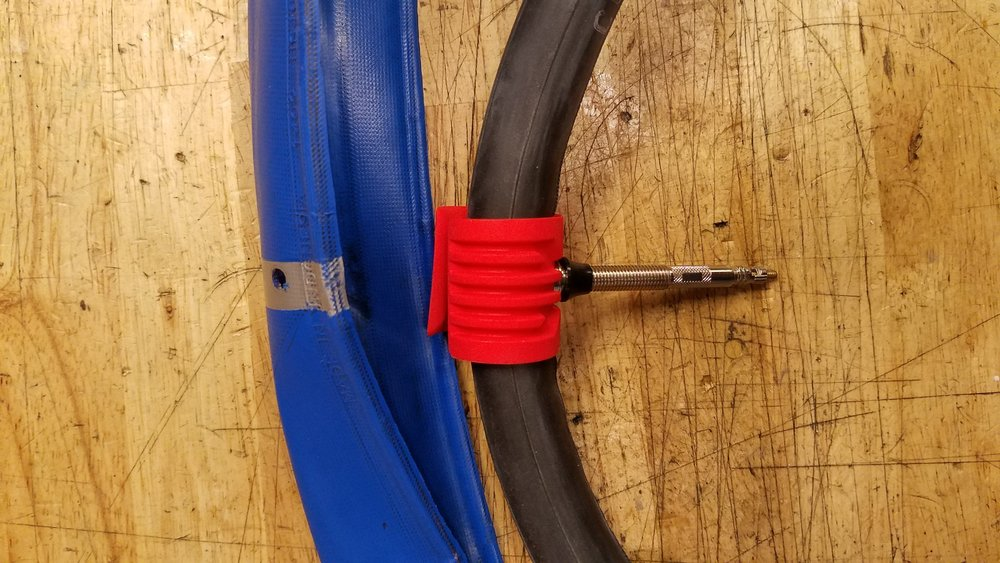 Next, place the valve through the air guide, and inflate the tube just enough to give it shape -- as if you were installing a normal tube in a standard clincher tire.