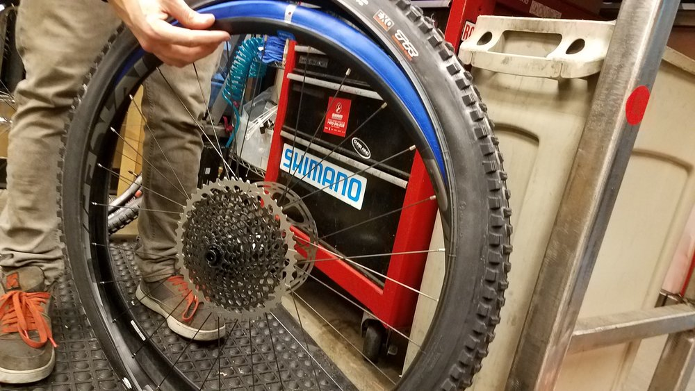 Position the logo as you see fit, and mount the tire one side at a time. It is crucial to install in this order, as any other way simply doesn't happen.