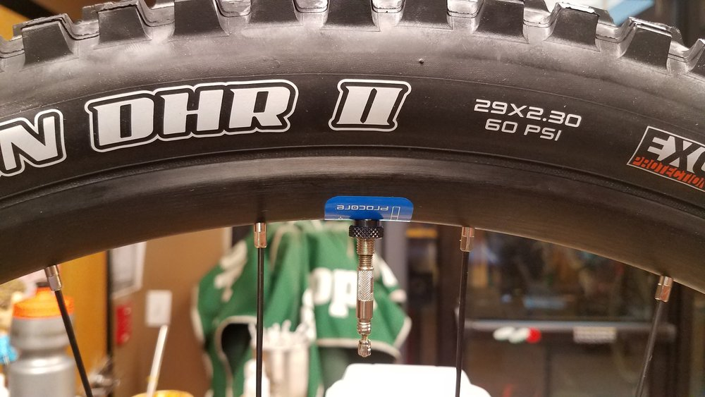 Begin by inflating the inner chamber gradually until the ProCore tire pushes the outer tire against the rim and seats. Unthread the valve to access the tire's air chamber, and inflate until it seats fully, then set to your desired pressure.