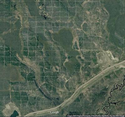 Cutlines for a dense 3D survey at Surmont field, Alberta, Canada. Image: Google Maps.
