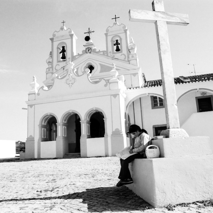 soul-frames: Rural scenes. A child doing her homework on the village cross monument (Alentejo, Portugal) Shot with Tri-x 400 6x6 film. © André Paxiuta / soul-frames.com