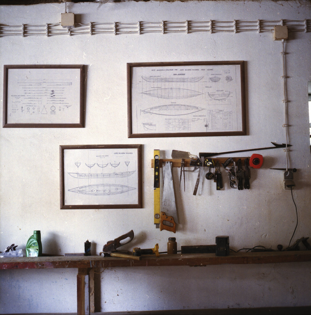 Whaling-boat plans hanging on the wall of Mestre João's workshop.