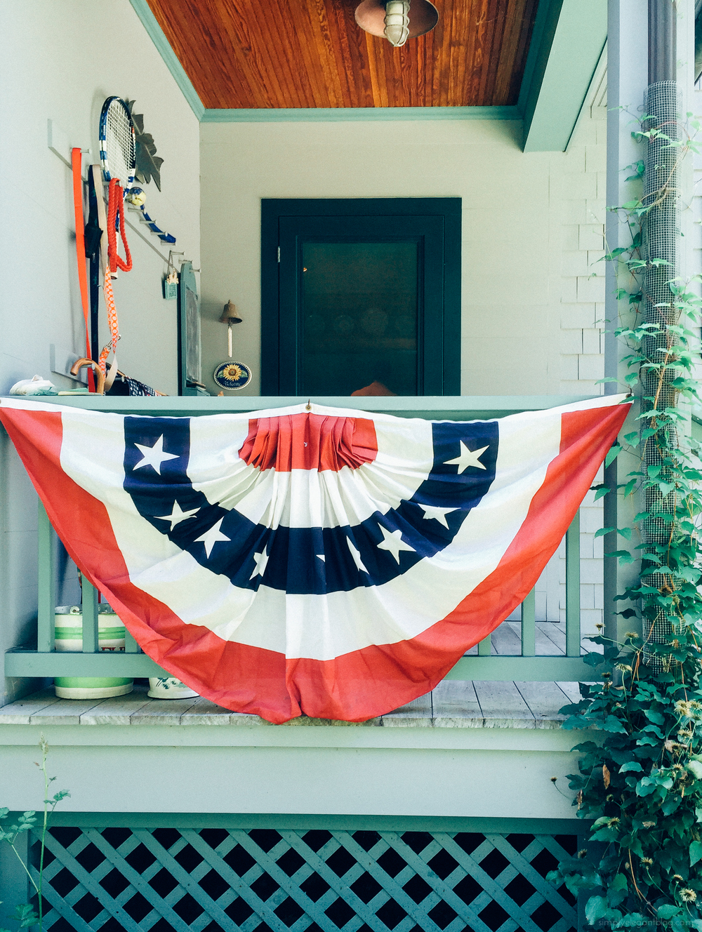 my mom added some patriotic flair to our front porch