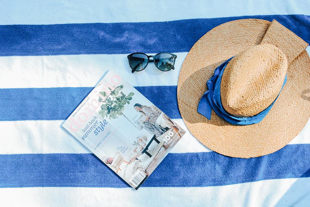 Domino Magazine and Lola Straw Hat.