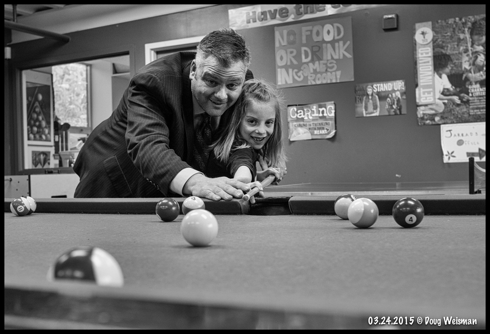 Teaching the finer points of pool.