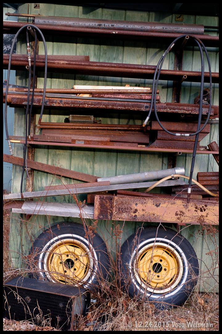 Old, rusty stuff, on two wheels.