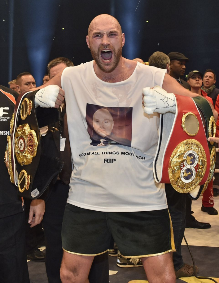 Tyson Fury in a show of emotion after his big win over Wladimir Klitschko in Germany Photo Credit: (AP Photo/Martin Meissner)