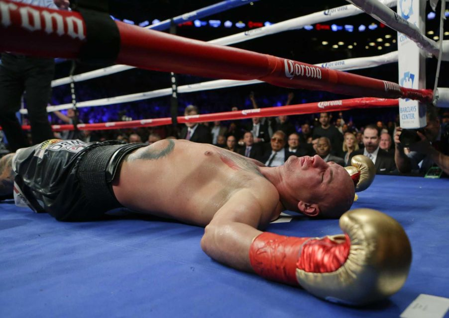 Artur Szpilka lay motionless after being brutally knocked out in round 9 of his fight with Deontay Wilder.  Credit: Getty Images/ DON EMMERT STF