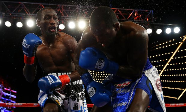 Terence Crawford drops and finishes off Hank Lundy inside of five rounds. Photo credit Mike Stobe/Getty Images