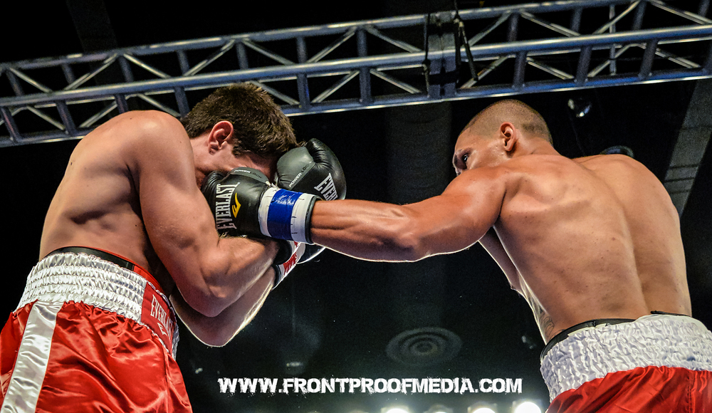 Sammy Valentin lands a big left hook to the head. Photo Credit: Joseph Correa/Frontproof Media