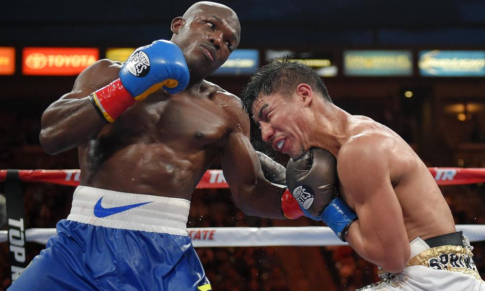 Bradley lands a flush left hook to the chin of Vargas. Photo Credit: Mark J. Terrill/AP