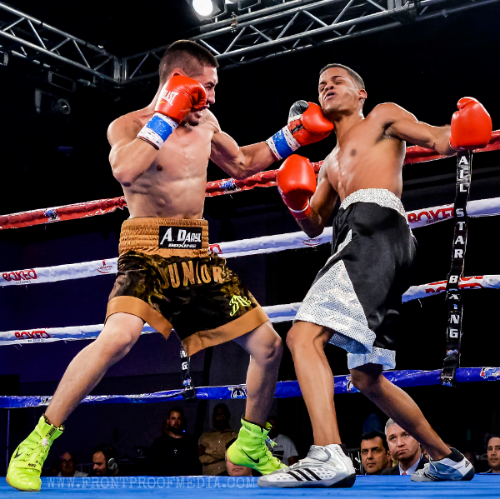 Santiago Arroyo lands a crushing left hook which left in the final round to score a big knockout over Luis Villegas. Photo Credit: Joseph Correa/Frontproof Media