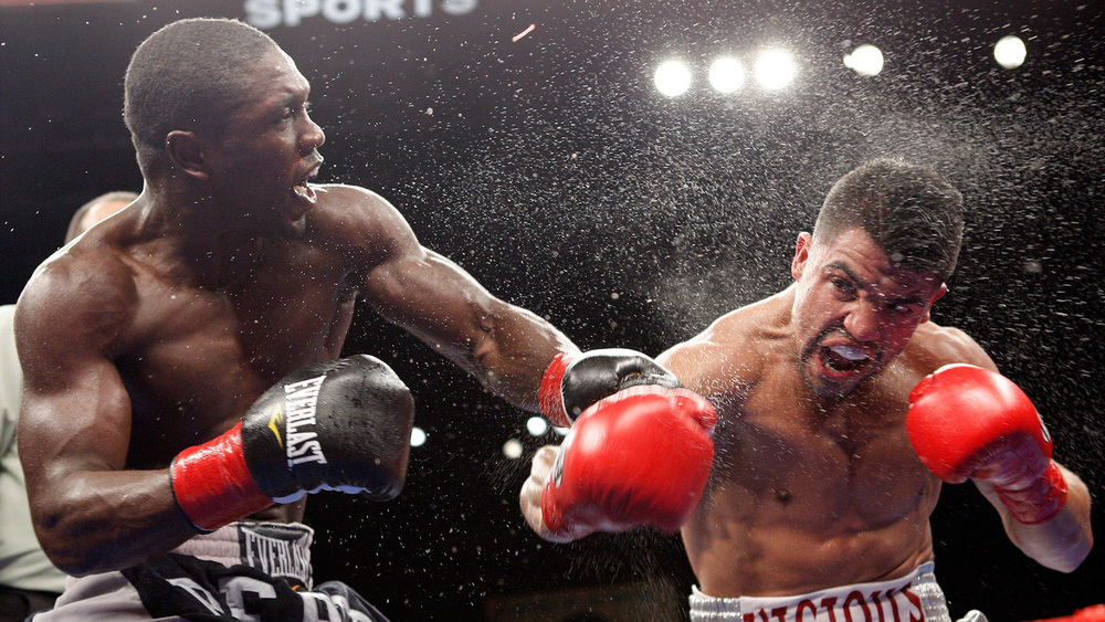 Andre Berto and Victor Ortiz exchange blows in their first meeting in 2011. Photo: HBO