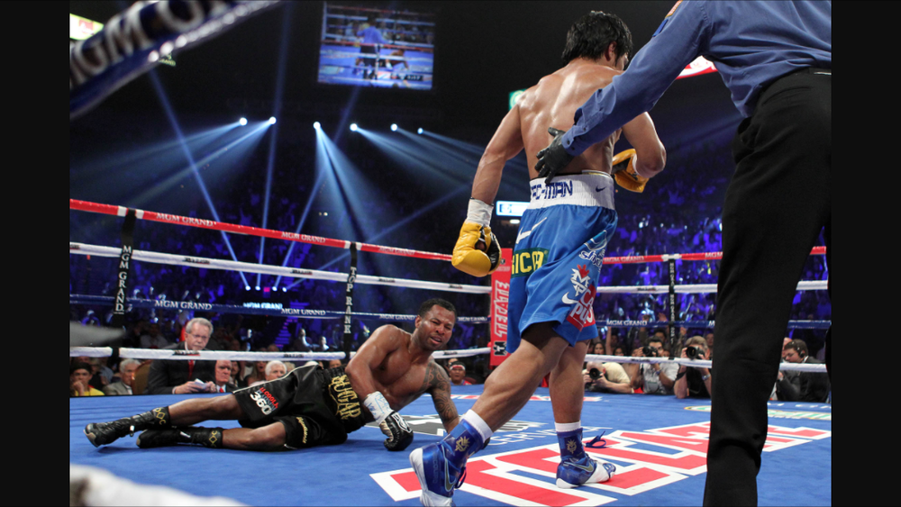 Pacquiao walking away after he drops Mosley with a straight left. Photo: Tom Casino/Showtime