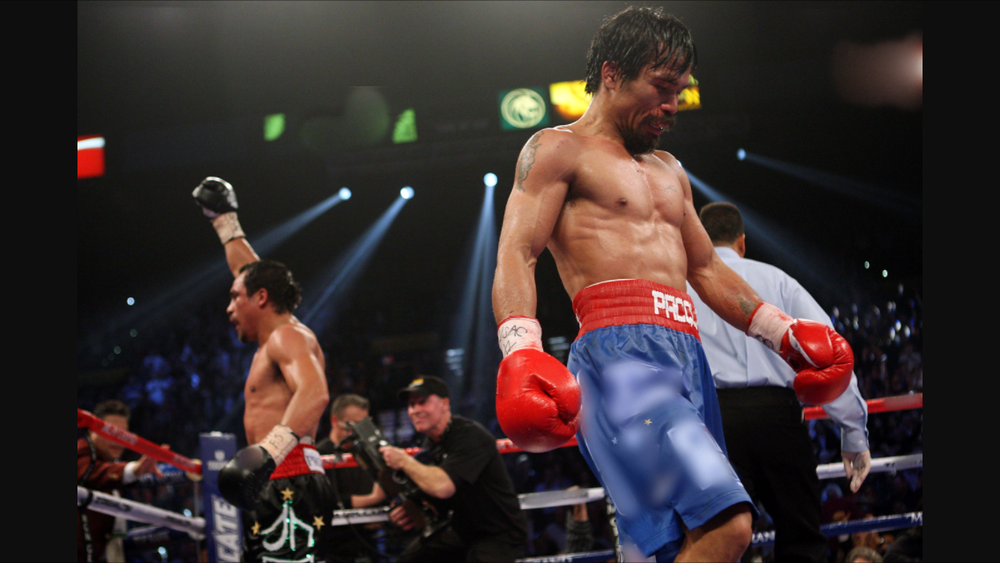 Pacquiao-Marquez III after the final bell rang. Photo: Chris Cozzone