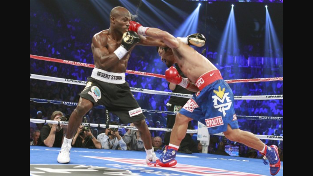 Pacquiao lands a left on Timothy Bradley. Photo: Kevork Djansezian