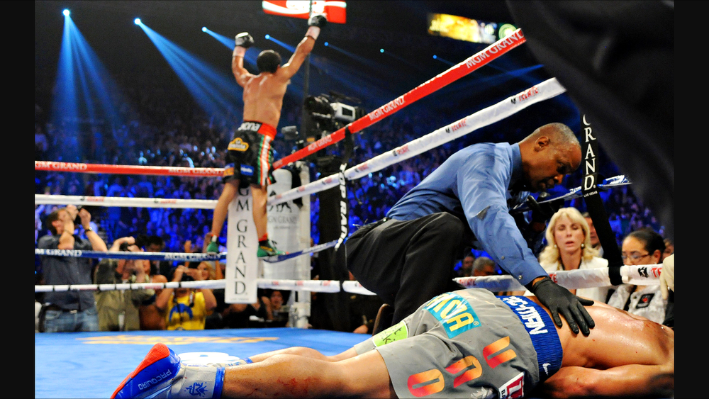 Marquez celebrates his knockout victory over a fallen Pacquiao. Photo: HBO