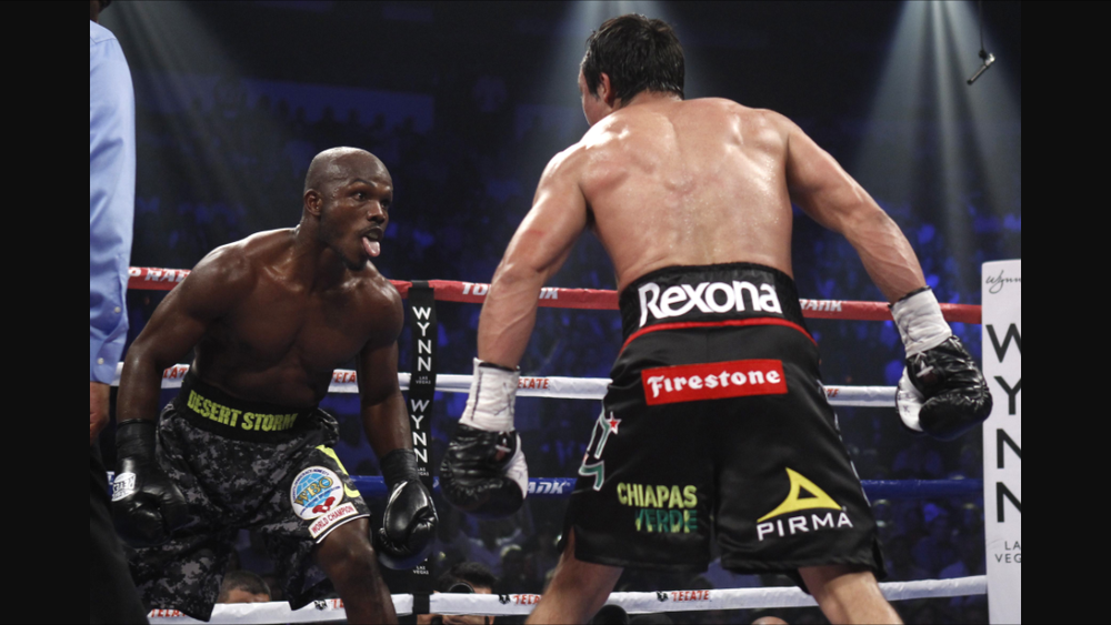 Bradley taunts Marquez during their bout in October 2013. Photo: HBO