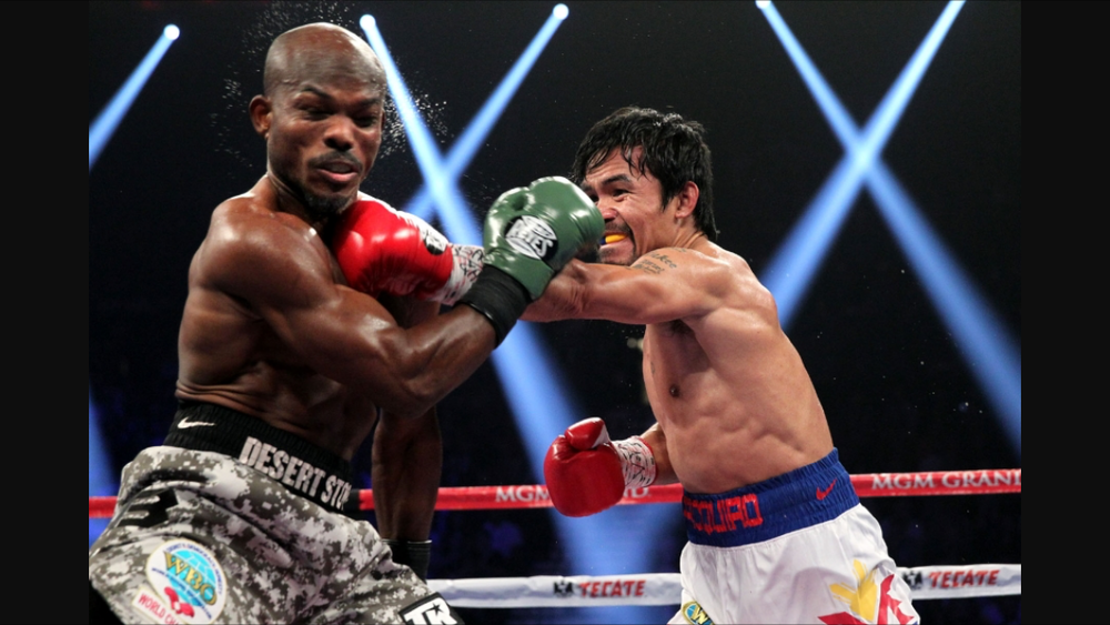 Pacquiao lands a straight left hand on Timothy Bradley in their second fight. Photo: Chris Farina/TopRank