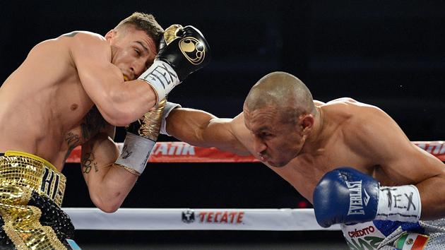 Orlando Salido defeats Vasyl Lomachenko during their 2014 bout. Photo credit: Naoki Fukuda
