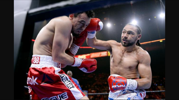 Thurman lands a right hand on Robert Guerrero. Photo: Harry How/Getty Images