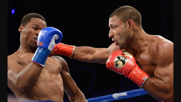 Kell Brook lands a right hand on Shawn Porter. Photo: Naoki Fukuda