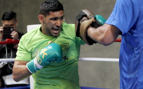 Amir Khan prepares for the biggest fight of his career. Photo Credit: Golden Boy Promotions