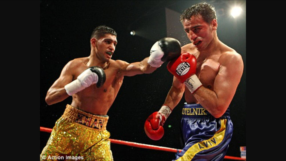 Khan Lands a straight left jab on Kotelnik. Photo: Action Images