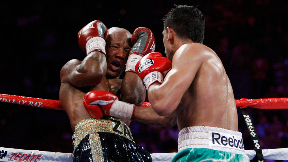 Khan on the attack against a hurt Zab Judah. Photo: HBO Sports/HBO Boxing