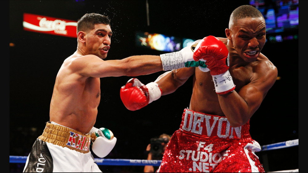 Khan lands a right hand on Devon Alexander. Photo: Jason Cairnduff/Action Images