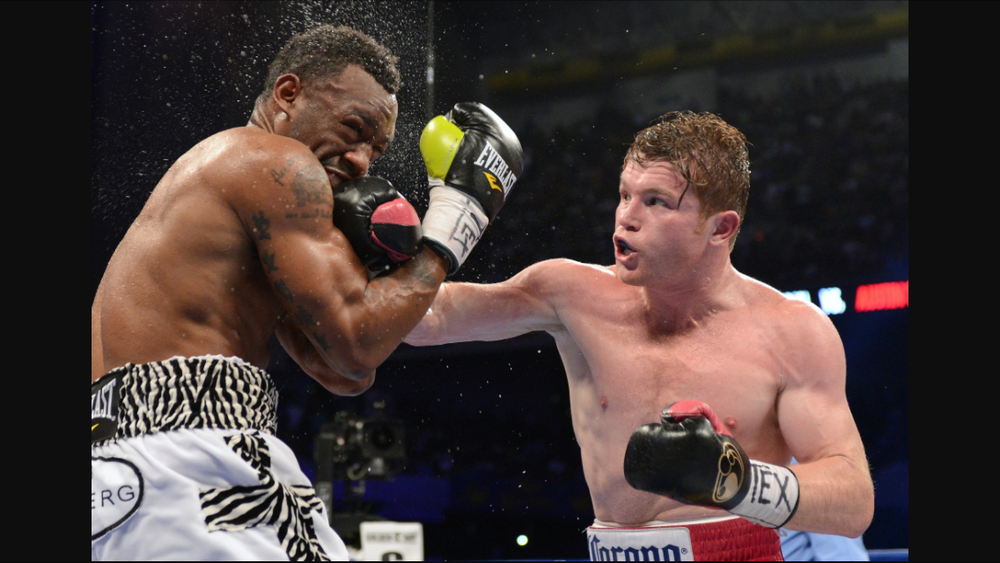 Canelo lands a hard right hand on Austin Trout. Photo: Naoki Fukuda