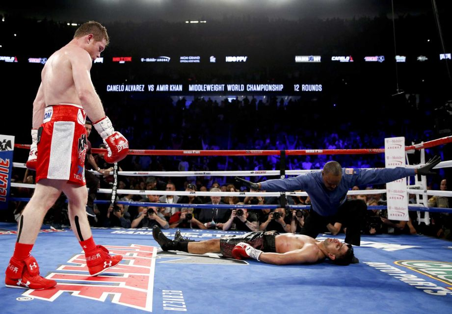 Canelo Alvarez knocks Amir Khan out in Dramatic fashion.  (Credit: AP/ John Locher)